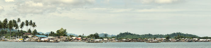 Village of fishermen on tropical coast.Panorama. Stock Image
