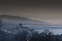 Village with fog. Mountain village with passing fog Royalty Free Stock Photography