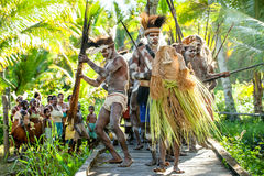 The Village follows the ancestors embodied in spirit mask as they tour the village the Doroe ceremony Stock Photos