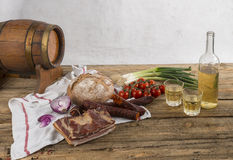 Village food. On a rustic wooden table. Bacon,sausage and good hungarian wine Stock Photography
