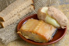 Village food (still life). Potatoes, dried fish-catfish, black bread Stock Image