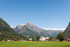 Village at the foot of mountain in Norway Stock Photography