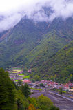 Village at foot of mountain Royalty Free Stock Photo