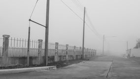 The village is full of the fog which is really hard to see the r. The scary path to nowhere, the fog is cover everything Stock Image