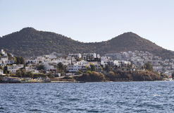 Village full of summer houses. In Yalikavak area in Bodrum peninsula. Architectural style of the region is all white homes Royalty Free Stock Photography
