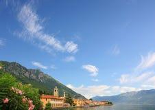 Village at garda lake shore, blue sky background Stock Photos