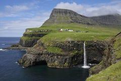 Gasaladur and waterfall into the sea, Vagar Island, Faroes