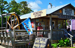 Village General Store Southport, NC. Village General Store in Southport, NC with some old antique coca cola signs hanging out front and a water wheel on the side Royalty Free Stock Photo