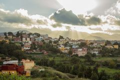 Village in Gran Canaria at sunset. With sun and clouds Stock Photos
