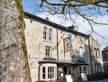 The village of Grassington in the Yorkshire Dales and Linton Falls. Grassington is a village in the Craven district of North Yorkshire, England. The village is Royalty Free Stock Photo