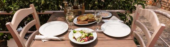 Village greek salad and snacks in greek tavern. royalty free stock photo