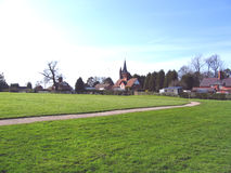 Village Green in Cheshire Village of Aldford. Village Green and Church in Cheshire Village of Aldford stock photography