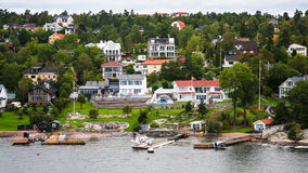 Village in green forest in suburbs of Stockholm Stock Image