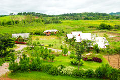 Village and green grass in thailand Stock Photos