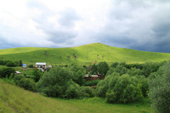 Village on a green hill Royalty Free Stock Images