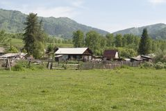 Village in Russia. Village among green hills, wooden old houses, summer, beautiful landscape, Russia Stock Photography