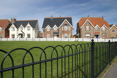 Village Green Houses in a Row. Houses bordering a village grren Royalty Free Stock Photos