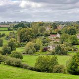 Village in a Green Leafy Valley Royalty Free Stock Photo