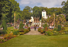 Village Green Portmeirion. In the centre of Portmeirion is a village green, surrounded by beautiful gardens Stock Image