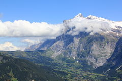 The village Grindelwald and the Wetterhorn, Switzerland. View at the Grindelwald valley with the village Grindelwald and the Wetterhorn. Berner Oberland stock photos