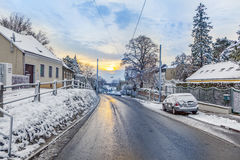 Village of Grinzing in early morning light in Wintertime Stock Photo