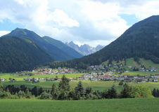 Village and hay field in the Austrian Alps Royalty Free Stock Photos