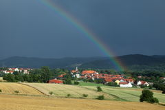 Village of Herleshausen with a rainbow after a summer thunderstorm Royalty Free Stock Photo