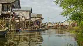 Village on high wooden stilts on Tonle Sap lake. Fishing village stock footage