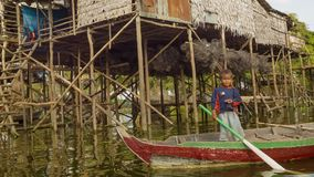 Village on high wooden stilts on Tonle Sap lake. Tonle Sap is the largest freshwater lake in So stock footage