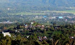 Village on hills Stock Images