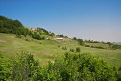 Village on hills Stock Image