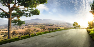 Village hills nature landscape. road in motion bluring. Sunny day royalty free stock image