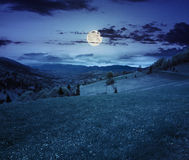 Village on hillside meadow at night Royalty Free Stock Photo