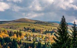 Village on hillsides in mountains Stock Photos