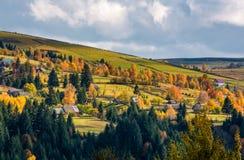 Village on hillsides in mountains Stock Photo