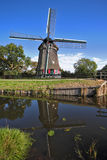 The village in Holland with windmills and  channel Royalty Free Stock Photography