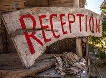 Village hotel. reception sign Stock Photos