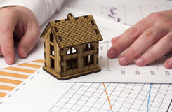 Village house on the charts Stock Photo