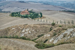 Village house in the middle of fields for agroturismo in Tuscany, Italy. Stock Images