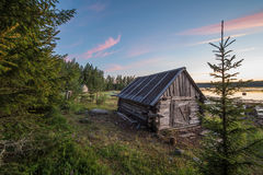 Village house near of the White Sea during the sunset Royalty Free Stock Photography
