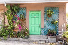 Free Village House With A Front Closed Green Door And Flowers In Charlotte Amalie, St. Thomas Royalty Free Stock Images - 186704099