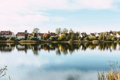 Village Houses Near Rippling Body of Water stock photo