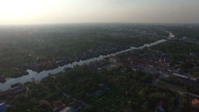 Village houses near the river. Arial view of village houses near the river. Shot with a Canon 5D Mark II stock footage