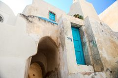 Village houses with old staircases in greek town Stock Photography