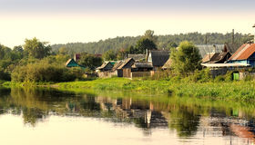 Village houses on the river bank Stock Photo