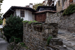 Village houses with rock solid walls, rural architecture backgro Stock Photo