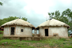 Village huts at Udaipur. Two beautiful tribal huts in village, Shilpgram at Udaipur, Rajasthan, India stock images