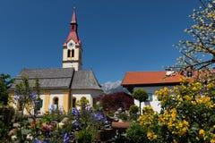 The village of Igls near Innsbruck, Austria. The village of Igls in the Summer. Igls is a small holiday village which is part of Innsbruck in the Tirol region of royalty free stock photography