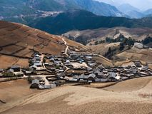 Village inside mountain. Yunnan province china, yellow ground royalty free stock photo