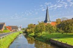 Village of Jork, Altes Land region, Lower Saxony. Canal through the village of Jork, Altes Land region, Lower Saxony, Germany stock photos